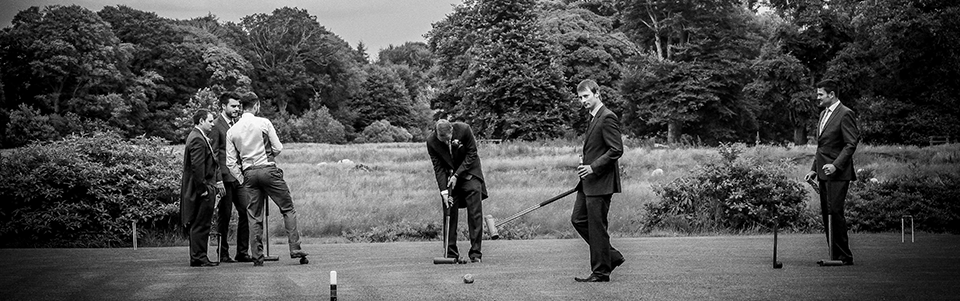 Groomsmen enjoy a game at Warwick Hall